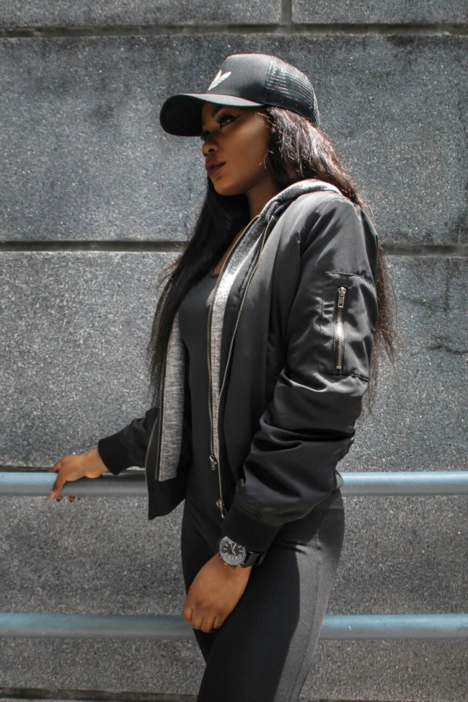 Billykiss Azeez - Your Favourite Muse -Urban Outfit - Fashionnova Black Jumpsuit, Fashionnova Black bomber jacket, adidas cap, adidas blue supercolor sneakers